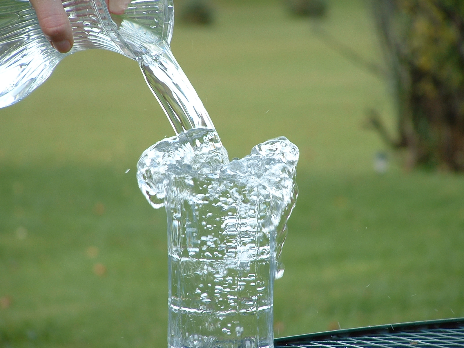 Overflowing glass of water.